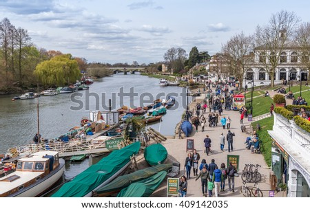 RICHMOND UPON THAMES, UK - APR 10: People enjoy the sunny weather in Richmond Upon Thames near London on April 10, 2016. The town is in proximity of a large number of parks, including Richmond Park