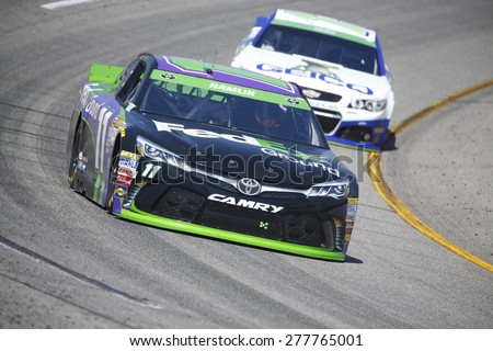 Richmond, VA - Apr 24, 2015:  Denny Hamlin (11) brings his race car through the turns during a practice session for the Toyota Owners 400 race at the Richmond International Raceway in Richmond, VA. - stock photo
