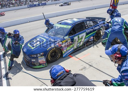 Richmond, VA - Apr 26, 2015:  Ricky Stenhouse Jr. (17) brings his race car in for service during the Toyota Owners 400 race at the Richmond International Raceway in Richmond, VA. - stock photo