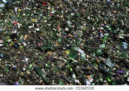 RICHMOND, VA - CIRCA 2009: A pile of crushed green glass lie in a heap at an undisclosed recycling facility circa 2009 in Richmond. The glass will be recycled.