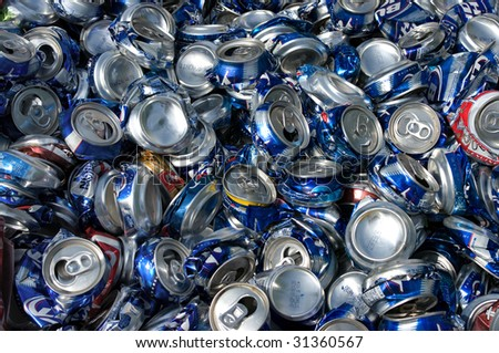 RICHMOND, VA - CIRCA 2009: Crushed aluminum cans lie in a heap at an undisclosed recycling facility circa 2009 in Richmond. The cans will be shipped to an aluminum foundry. - stock photo
