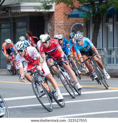 RICHMOND, VIRGINIA - SEPTEMBER 27: Cyclists compete in the elite men's road race at the UCI Road World Championships on September 27, 2015 in Richmond, Virginia - stock photo