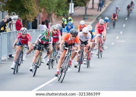RICHMOND, VIRGINIA â?? SEPTEMBER 25: Cyclists compete in the junior womenâ??s road race at the UCI Road World Championships on September 25, 2015 in Richmond, Virginia - stock photo