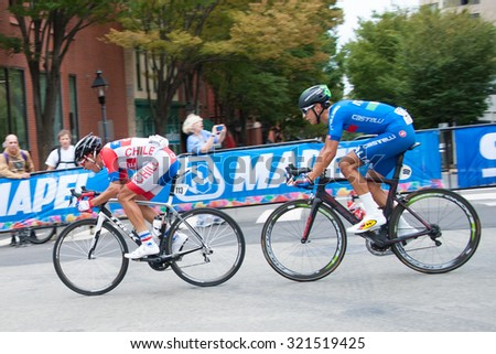 RICHMOND, VIRGINIA   SEPTEMBER 25: Cyclists compete in the under-23 men's road race at the UCI Road World Championships on September 25, 2015 in Richmond, Virginia  - stock photo
