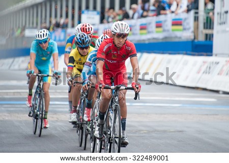 RICHMOND, VIRGINIA - SEPTEMBER 26: Cyclists cross the finish line of the junior men's road race at the UCI Road World Championships on September 26, 2015 in Richmond, Virginia
