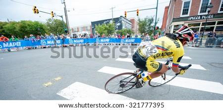 RICHMOND VIRGINIA - SEPTEMBER 26: Miryan Nunez (ECU) takes a corner in the elite women's road race at the UCI Road World Championships on September 26, 2015 in Richmond, Virginia - stock photo