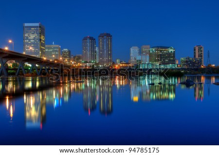 Richmond, Virginia skyline overlooking the James River at sunset. - stock photo