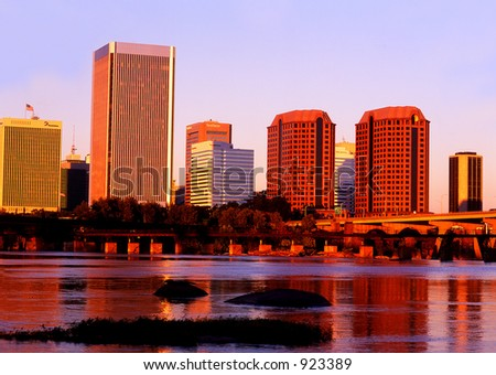 Richmond Virginia Skyline reflected in the James River The James River - stock photo