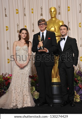 Rick Carter with Daniel Radcliffe & Kristen Stewart at the 85th Academy Awards at the Dolby Theatre, Los Angeles. February 24, 2013  Los Angeles, CA Picture: Paul Smith / Featureflash