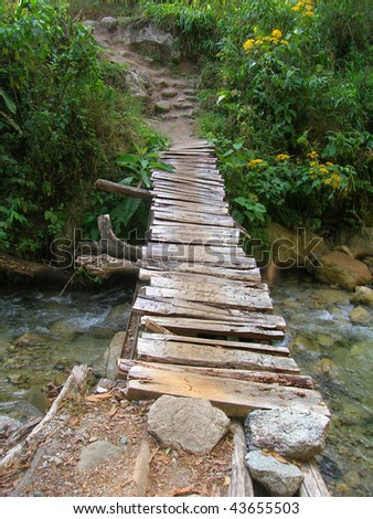 Rickety wooden bridge on the way to the Mandor waterfalls near Machu Picchu - stock photo