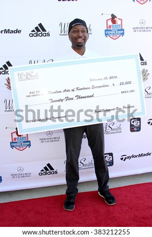 Ricky Smith with a donation )Will and Jada Smith Foundation) at the inaugural Stephen Bishop celebrity golf invitational to benefit R.A.K.E. , Feb. 15, 2016 at Calabasas Country Club in Calabasas, CA. - stock photo