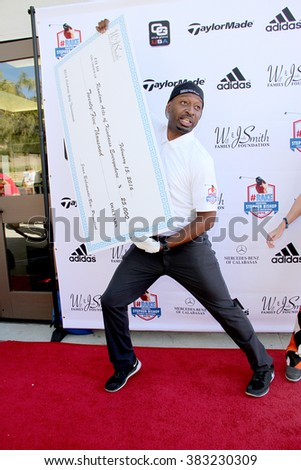 Ricky Smith with a donation (Will and Jada Smith Foundation) at the inaugural Stephen Bishop celebrity golf invitational benefiting R.A.K.E., Feb. 15, 2016 at Calabasas Country Club in Calabasas, CA. - stock photo