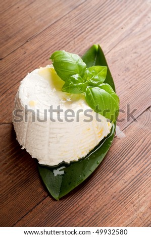 ricotta and basil on wood background - stock photo