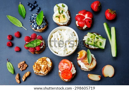 ricotta and crostini appetizers with fillings on a black background. the toning. selective focus