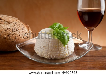 ricotta with bread and glass of red wine - stock photo
