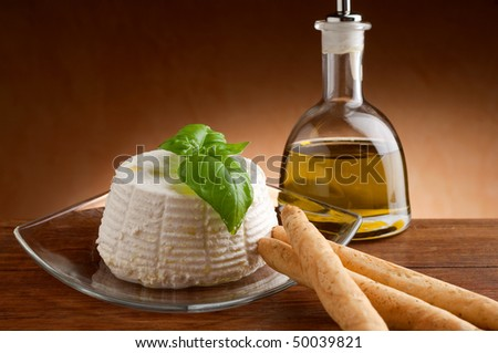 ricotta with bread-stick and oil - stock photo