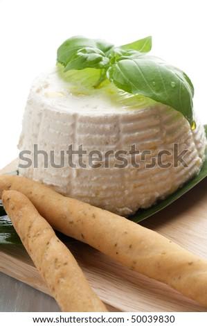 ricotta with bread-stick close up - stock photo