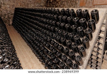 Riddling rack used for ageing sparkling wines on the lees and clearing the drink - stock photo