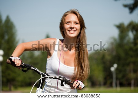 ride a bike on the summer park