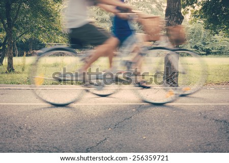 Ride bike in the park vintage color - stock photo