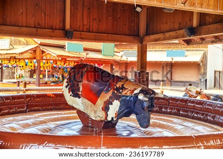 Ride  of the bull in park amusement. - stock photo