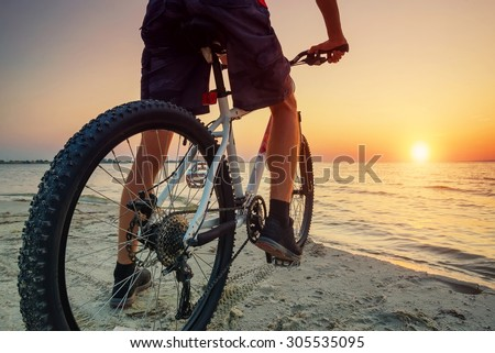 Ride on bike on the beach. Sport and active life concept - stock photo