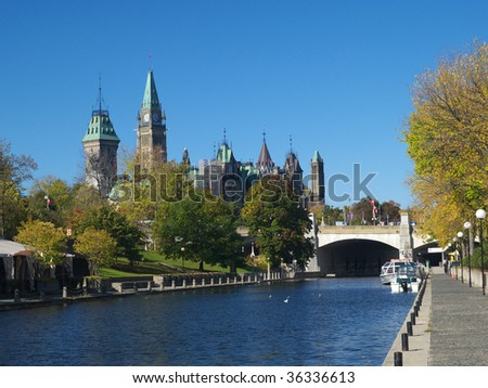 Rideau canal and Canadian parliament - stock photo