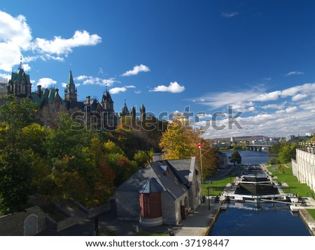 Rideau canal and Canadian parliament in autumn - stock photo