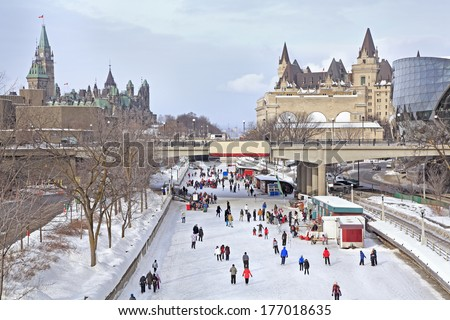 Rideau Canal skating rink, Parliament of Canada in winter, Ottawa - stock photo