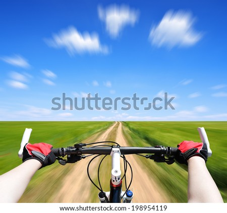 Rider driving bicycle. Motion blurred background  - stock photo