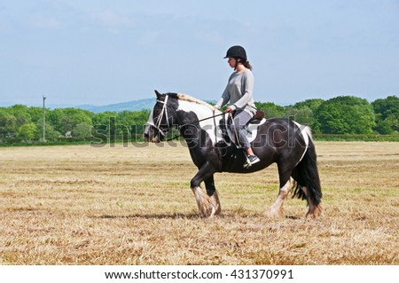 Rider making use of the open space provided by a farmers recently cut crop field.