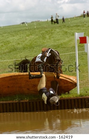 Rider Takes a Fall (Rider unhurt - just wet!) - stock photo
