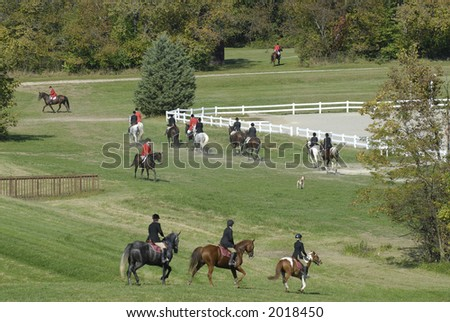 Riders in the country gather for a fox hunt.