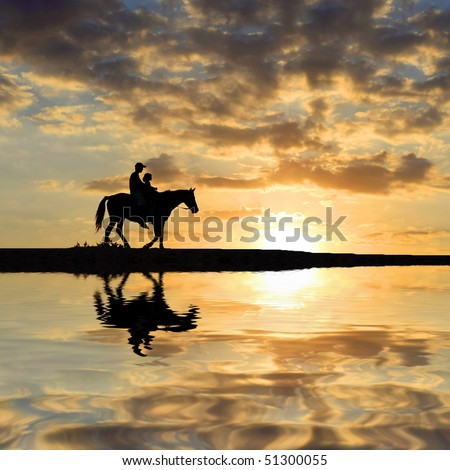 Riders on sunset background - stock photo