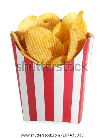Ridged potato chips in red white cardboard box - stock photo