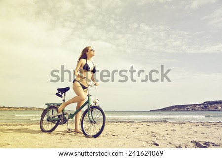 Riding a bike at the beach  - stock photo