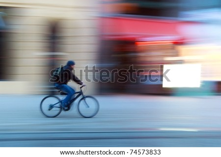 Riding a bike on a street - stock photo