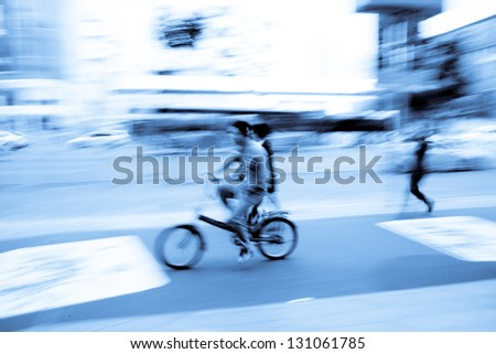 Riding a bike on city street - stock photo