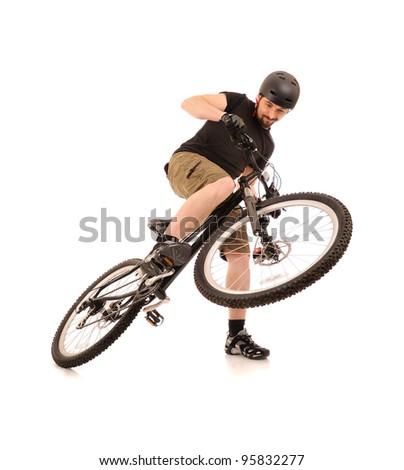 Riding bicyclist isolated on white, studio shot. - stock photo