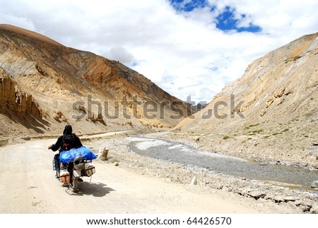 riding himalaya with a motorcycle - stock photo