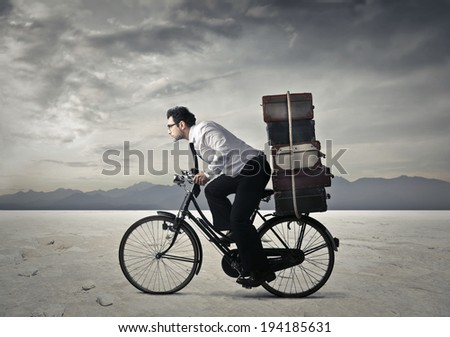 riding his bike - stock photo
