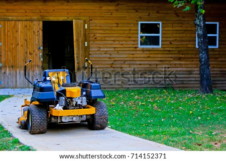 Riding Lawn Mower Parks on the Ground.