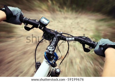 Riding on a bike on forest's path - stock photo