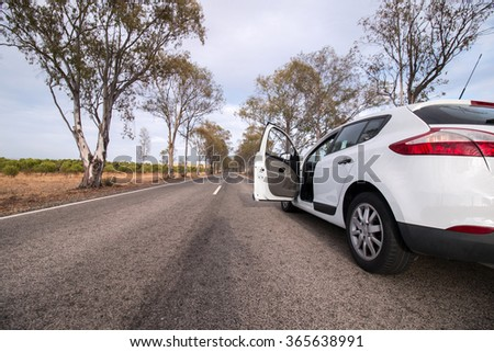 Riding on my car on the beautiful countryside on a very long road. - stock photo