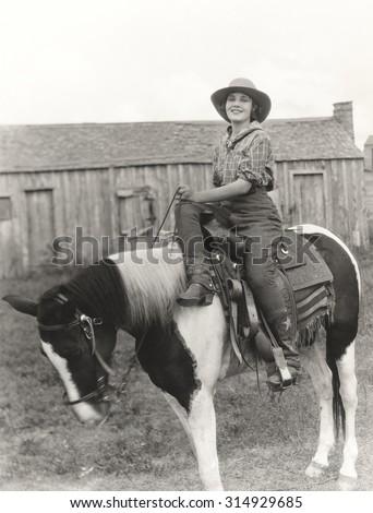 Riding side saddle - stock photo