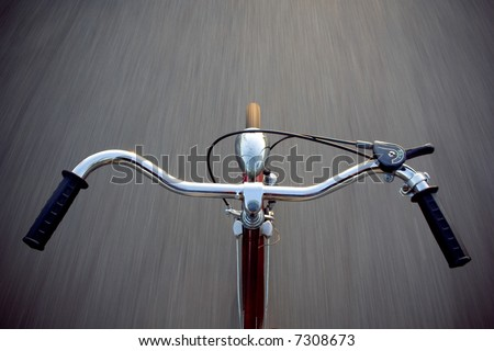 riding the bicycle with no hands - stock photo