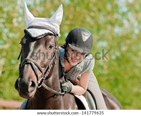 riding young woman on horse in outdoor - stock photo