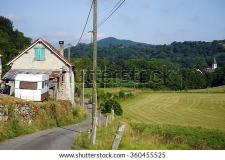 RIEULHES, FRANCE - CIRCA JULY 2015 Farm house, field and church                                 - stock photo