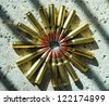 rifle ammunition laid out in a circle - stock photo