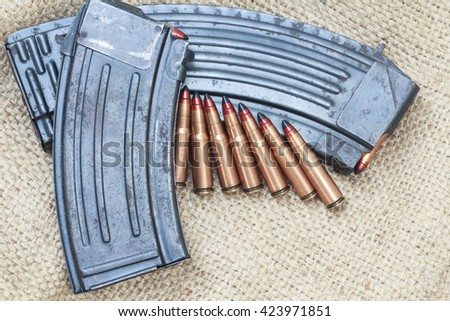 rifle bullet and ammunition pouch. Choose a focal point ammunition lying. - stock photo